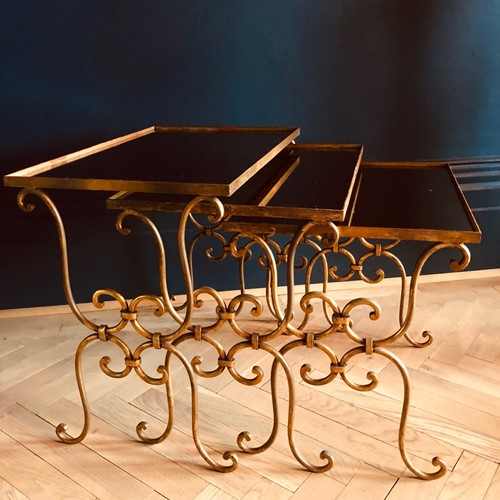 Gilt metal mirrored glass nesting tables