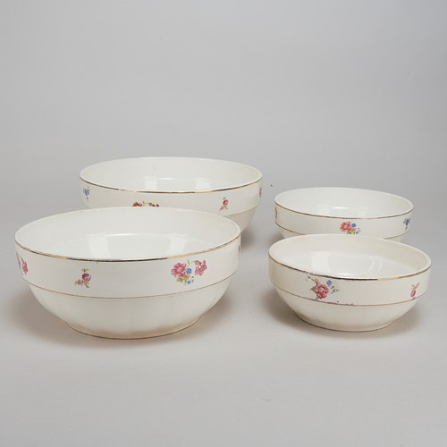 Set of four French china stacking mixing bowls