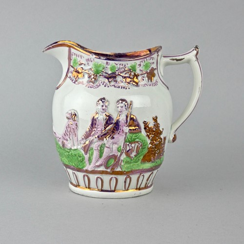 Pink lustre jug moulded with huntsmen