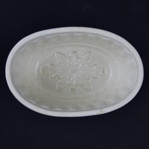 Mould with stylised flower to base