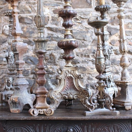 A collection of early pricket and candlesticks