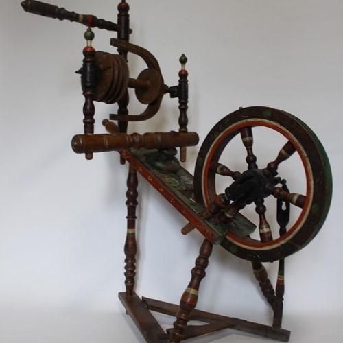 Early painted folk spinning wheel
