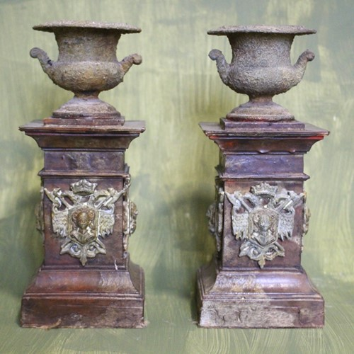 A pair of crusty urns
