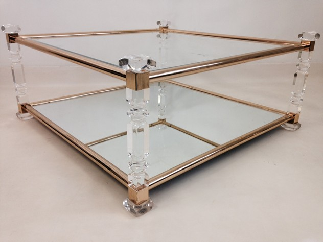 Acrylic and brass coffee table-august-interiors-cut lucite table1_main.jpeg