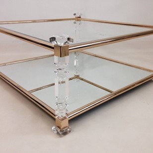 Acrylic and brass coffee table