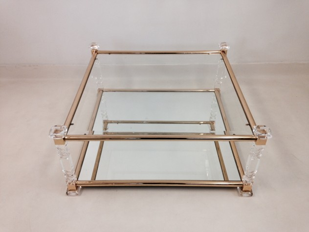 Acrylic and brass coffee table-august-interiors-cut lucite1_main.jpeg