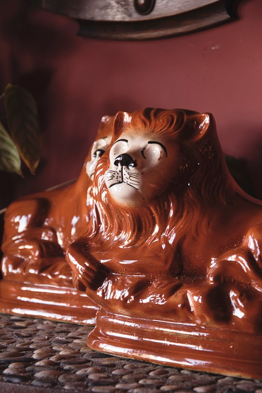 a pair of ceramic lions-dig-haushizzle-doubleleonard10-main-636879152655880820.jpg