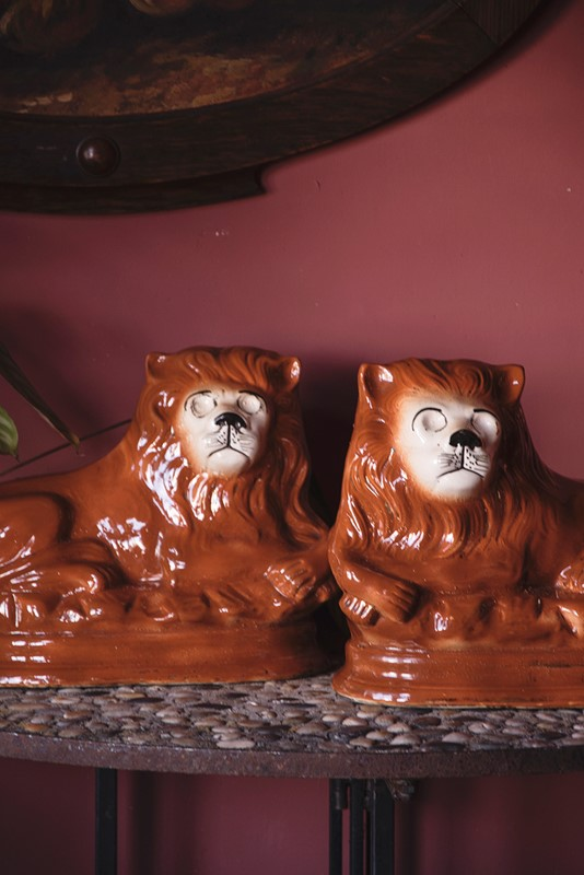 a pair of ceramic lions-dig-haushizzle-doubleleonard12-main-636879152551819014.jpg
