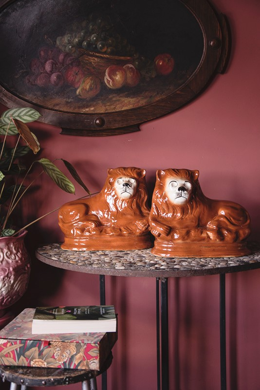 a pair of ceramic lions-dig-haushizzle-doubleleonard15-main-636879152381506270.jpg