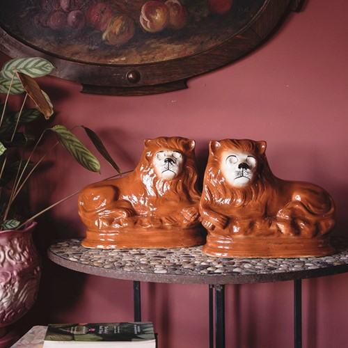 a pair of ceramic lions