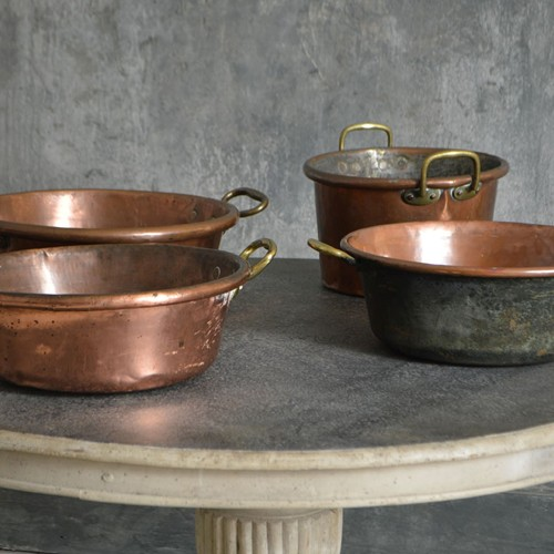 A selection of large French cooking pans