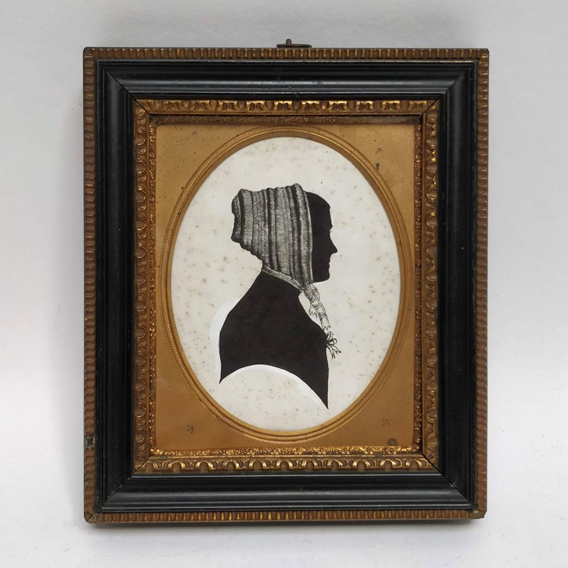 19th century silhouette of a lady in a bonnet-general-store-no-2-1-main-637047646813067445.jpg