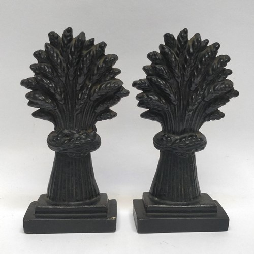 A pair of Wheatsheaf doorstops