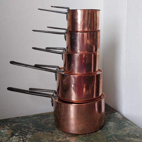 Five English Copper saucepans stamped I.S