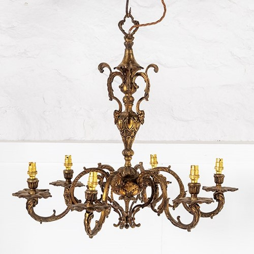 Gilded cast bronze six arm chandelier