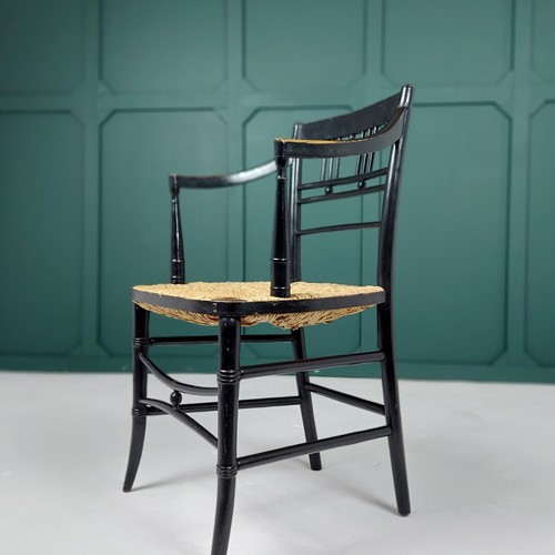An Ebonised Sussex Chair