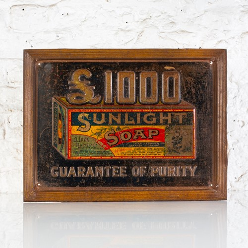 Early sunlight soap embossed tin advertising sign