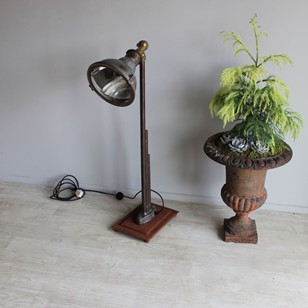 Industrial floor lamp with adjustable shade