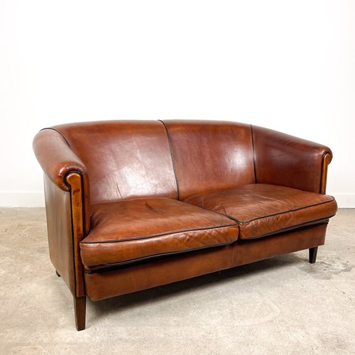 Vintage sheep leather two seater club sofa
