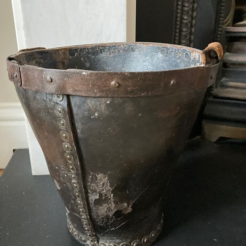 Old leather bucket perfect use as a paper bin
