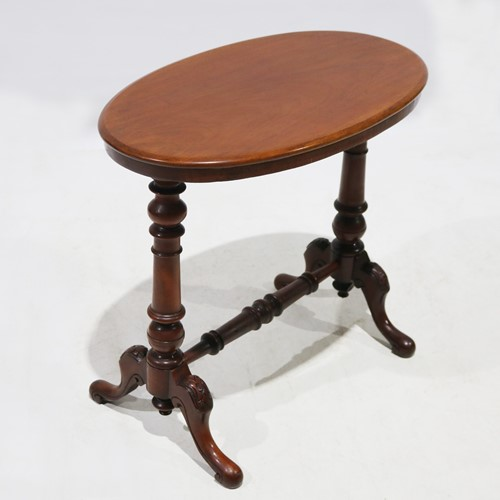 Late 19th Century Oval Stretcher Table in Mahogany