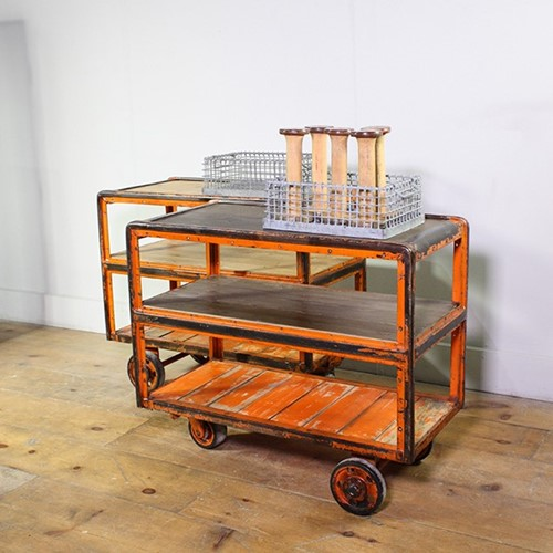 Orange metal framed Factory Trolleys