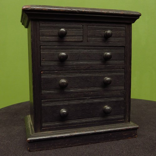 Antique ebonized apprentice piece chest of drawers