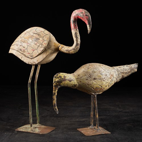 Weather-aged couple of wooden waterbirds